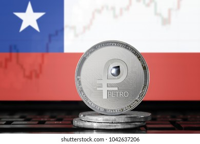 PETRO (PTR) cryptocurrency; coin el petro on the background of the flag of CHILE; national Venezuela cryptocurrency