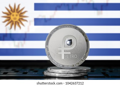 PETRO (PTR) cryptocurrency; coin el petro on the background of the flag of URUGUAY; national Venezuela cryptocurrency
