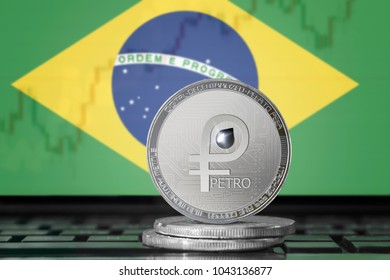 PETRO (PTR) cryptocurrency; coin el petro on the background of the flag of BRAZIL