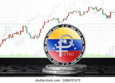 PETRO (PTR) cryptocurrency; physical concept petro coin with the flag of Venezuela on the background of the chart