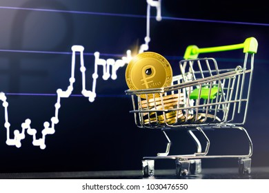 PETRO (PTR) cryptocurrency; shopping cart (trolley) with gold Venezuela petro coins on the background of the financial chart