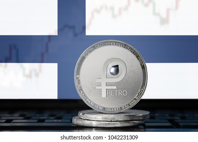 PETRO (PTR) national Venezuela cryptocurrency; coin el petro on the background of the flag of Finland (Republic of Finland)