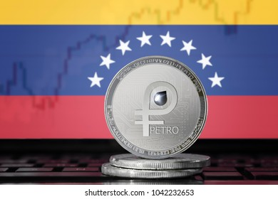 PETRO (PTR) national Venezuela cryptocurrency; coin el petro on the background of the flag of Venezuela