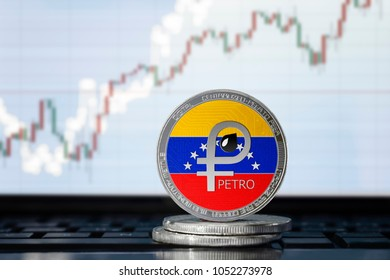 PETRO (PTR) Venezuela cryptocurrency; physical concept el petro coin with the flag of Venezuela on the background of the chart