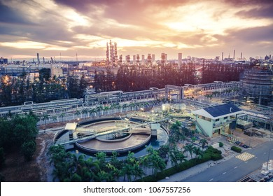 Petrochemical industrial estate on sunrise sky background with Wastewater treatment plant