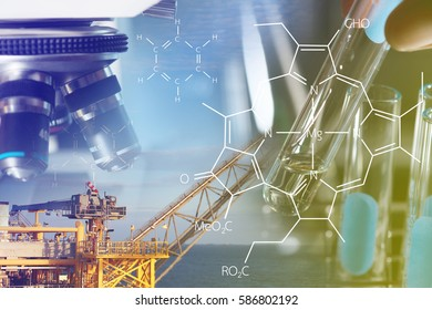 Petrochemical industry concept, Investigator checking test chemical tubes and oil rig.