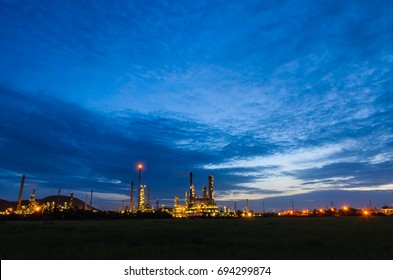 Petrochemical industry on sunset dark blue sky.