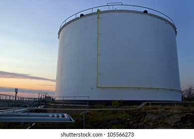Petrochemical oil tank and sunset in Finland