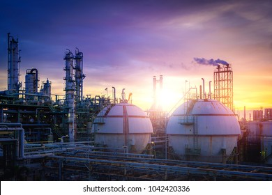 Petrochemical plant on sunset sky background with gas storage sphere tanks, Manufacturing of petroleum industrial, Gas distillation tower at twilight