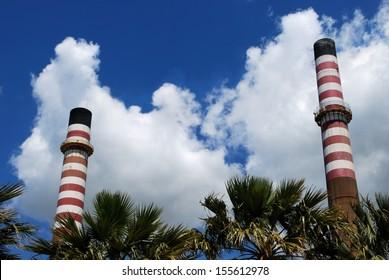 Petrochemical refinery chimney stacks, Puente Mayorga, Cadiz Province, Costa del Sol, Andalucia, Spain, Western Europe.