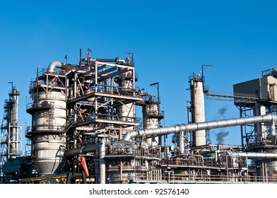 A petrochemical refinery plant with pipes and cooling towers.