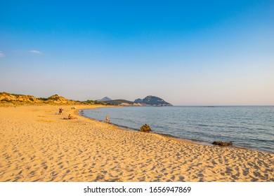 PETROCHORI, GREECE - JULY 2018: The beautiful sandy beach of Petrochori village located between Voidokoilia and Romanos beach, overlooking the Ionian Sea.