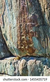 "Petroglyph complex ""kalbak - Tash"" (ritual sanctuary), Ongudai district, Altai Republic, Russia - July 15, 2019: rock paintings depicting animals"