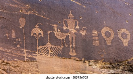 A petroglyph panel with a variety of humanoid and animal images portrayed on the cliffs of Butler Wash in the Comb Ridge aea of the new Bears Ears National Monument.