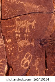 Petroglyphs carved, pecked or abraded out of rock by native americans that lived USA southwest./petroglyphs/Better known as rock art, was done by a primitive people dating back as far as 300 A.D.