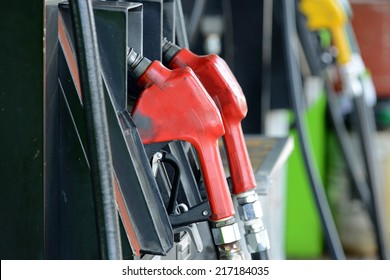 Petrol gas station pump and pumping gasoline fuel