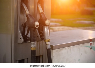 Petrol and gasoline nozzles at the fuel station