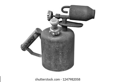 Petrol old fashioned blowtorch on white