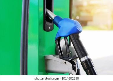 Petrol pump filling nozzles.