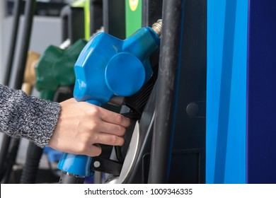 Petrol pump filling nozzles in gas station