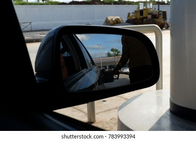 petrol station was looked through the car's mirror