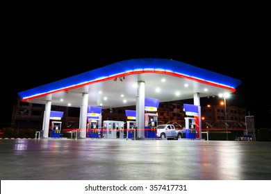 petrol station at night & copy space on top