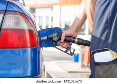 petrol tanker refuels gasoline car gasoline gun close-up