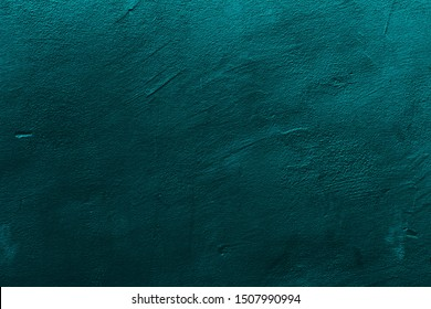 Petrol or teal colored background with textures of different shades of petrol or teal.