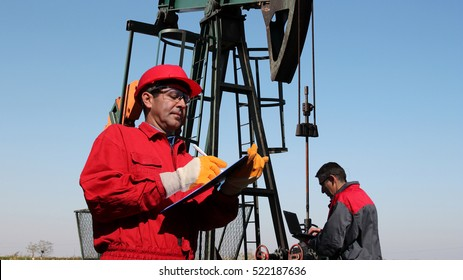 Petroleum Engineers Teamwork / Petroleum engineers at work in the oil and gas industry