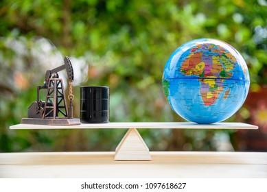 Petroleum industry, a saudi giant oil company listing stakes in an IPO or Initial Public Offering for capital concept : Pump jack, a crude oil drum or a barrel, a world globe on simple balance scale.