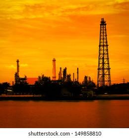Petroleum oil refinery factory near riverside in Thailand, warm tone