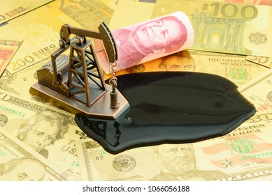 Petroleum, petrodollar and crude oil concept : Pump jack and China CNY yuan on US USD dollar notes, depicts the money received or earned from sales after investment in the development of oil industry.