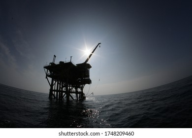 Petroleum platform oil and gas at sea, photo against light