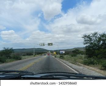 PETROLINA, PERNAMBUCO, BRAZIL - JANUARY 24, 2014: Highway BR-235 on the border of the states of Pernambuco and Bahia, near Santana do Sobrado in Bahia.