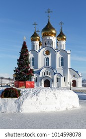 PETROPAVLOVSK CITY, KAMCHATKA PENINSULA, RUSSIA - JAN 6, 2018: Holy Trinity Orthodox Cathedral of Petropavlovsk, Kamchatka Diocese of Russian Orthodox Church and Christmas tree in front of building