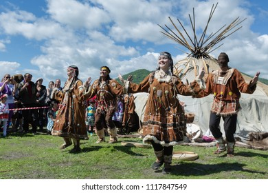 PETROPAVLOVSK CITY, KAMCHATKA PENINSULA, RUSSIA - JULY 11, 2015: Women and men in national clothing indigenous inhabitants of Kamchatka expression dancing near yaranga on Fishermans Day