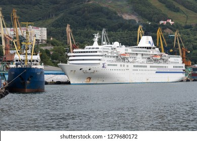 PETROPAVLOVSK CITY, KAMCHATKA PENINSULA, RUSSIA - 4 SEP, 2018: Summer view of Commercial Seaport of Petropavlovsk-Kamchatsky City - Russian fishing vessel Pamir and Japanese cruise liner Pacific Venus