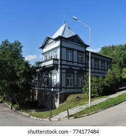 PETROPAVLOVSK CITY, KAMCHATKA PENINSULA, RUSSIAN FAR EAST - SEP 7, 2015: Summer view of old wooden building of museum of local lore - Kamchatka Regional Unified Museum in Petropavlovsk-Kamchatsky City