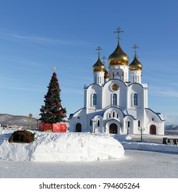 PETROPAVLOVSK CITY, KAMCHATKA, RUSSIA - JAN 6, 2018: Building of Holy Trinity Orthodox Cathedral of Petropavlovsk, Kamchatka Diocese of Russian Orthodox Church and Christmas tree in front of building