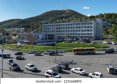 PETROPAVLOVSK KAMCHATSKY CITY, KAMCHATKA PENINSULA, RUSSIAN FAR EAST - SEP 10, 2018: Top view of building Avacha Hotel in city of Petropavlovsk-Kamchatsky and cars driving along main city road.