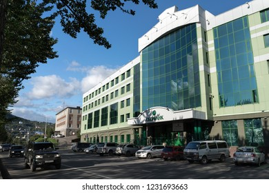 PETROPAVLOVSK KAMCHATSKY CITY, KAMCHATKA PENINSULA, RUSSIAN FAR EAST - SEP 10, 2018: View of modern building of Kamchatka Regional Head Offices Sberbank of Russia and cars driving along main city road