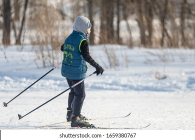 Petropavlovsk, Kazakhstan - February 29, 2020: People are skiing in the winter forest. Sunny winter landscape, skiing.