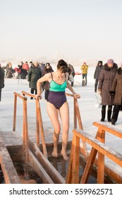 PETROPAVLOVSK, KAZAKHSTAN- JANUARY 19, 2017: The Baptism of Russia celebration. Orthodox church Holy Epiphany Day. People bathe in the hole. Weather -22, winter.