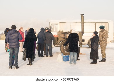 PETROPAVLOVSK, KAZAKHSTAN- JANUARY 19, 2017: The Baptism of Russia celebration. Orthodox church Holy Epiphany Day. People take water from the river. Weather -22, winter.