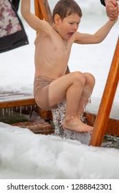PETROPAVLOVSK, KAZAKHSTAN, JANUARY 19, 2019: Baptism is a Christian holiday, religion. Men are immersed in the water of winter recreation. River Ishim Petropavlovsk Kazakhstan.