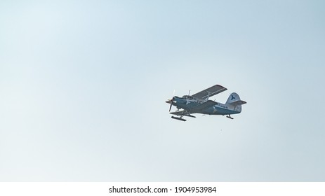 Petropavlovsk, Kazakhstan - January 20, 2021: Airplane in the air against the blue sky.