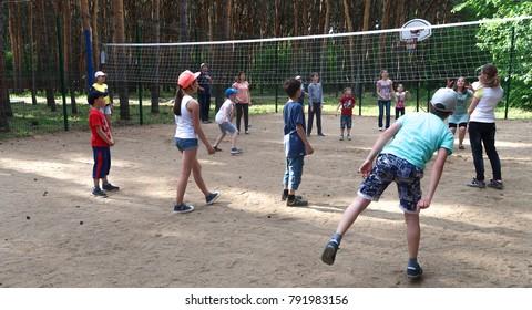 Petropavlovsk, Kazakhstan - June 3, 2017: Children in the woods play ball, park.