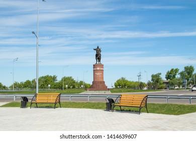 Petropavlovsk, Kazakhstan - June 3, 2019: Monument to the poet and commander Kozhabergen Zhyrau (1663–1763) at the entrance to the city of Petropavlovsk. Road street summer. Batyr on horseback.