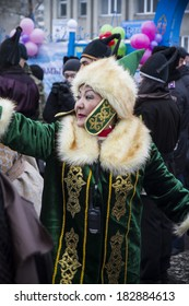 PETROPAVLOVSK, KAZAKHSTAN - MARCH 21, 2014: Muslim new year celebration. Woman in national dress Kazakh
