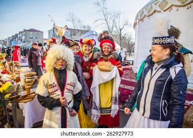 PETROPAVLOVSK, KAZAKHSTAN - MARCH 21, 2015: celebration of the new year on the solar calendar astronomical in Iranian and Turkic peoples. People in national clothes